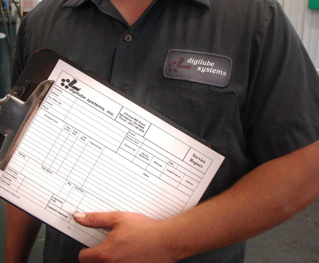 Digilube employee holding an order form